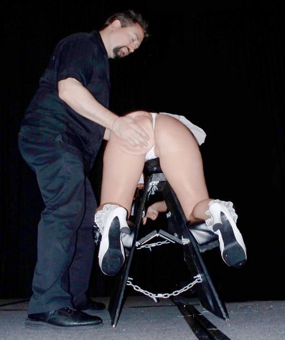 Woman on a spanking bench
